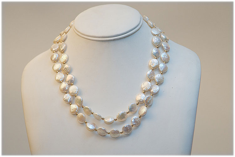 Two strand flat sweet water pearl necklace with 18 k gold
