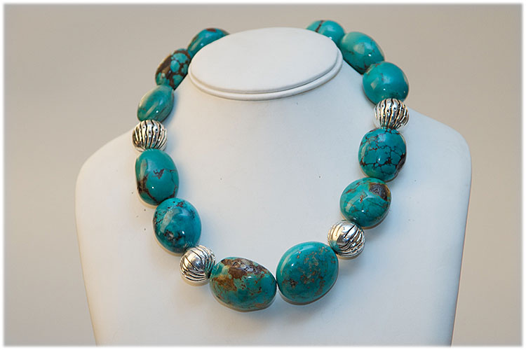 Very large turquoise stones and silver beads necklace