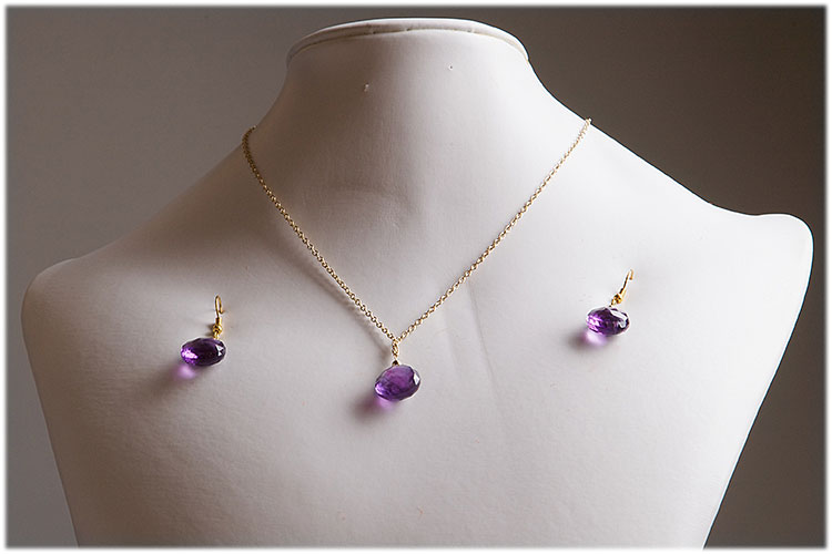 Small amethyst pendant with matching earrings