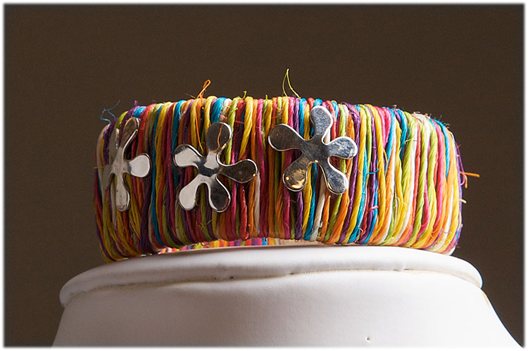 Small ethnic straw cuff with sterling silver flowers and closure