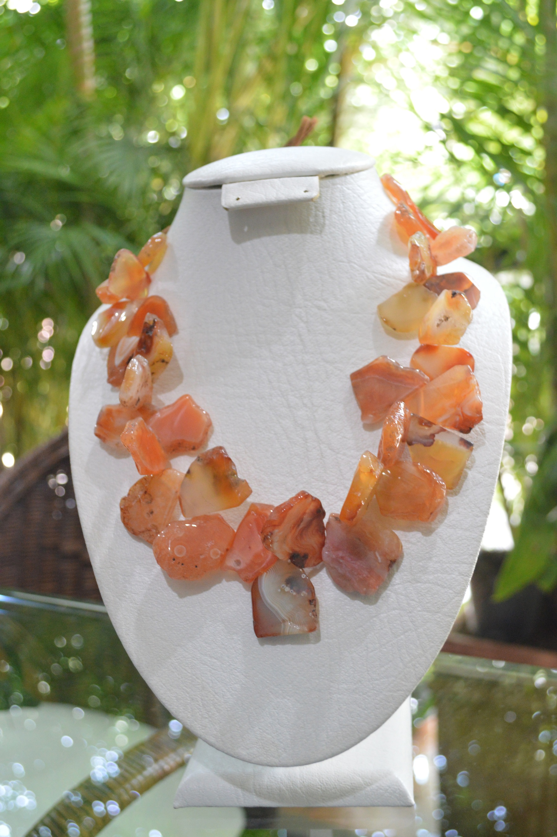 freeform orange agate necklace with leather attachment .