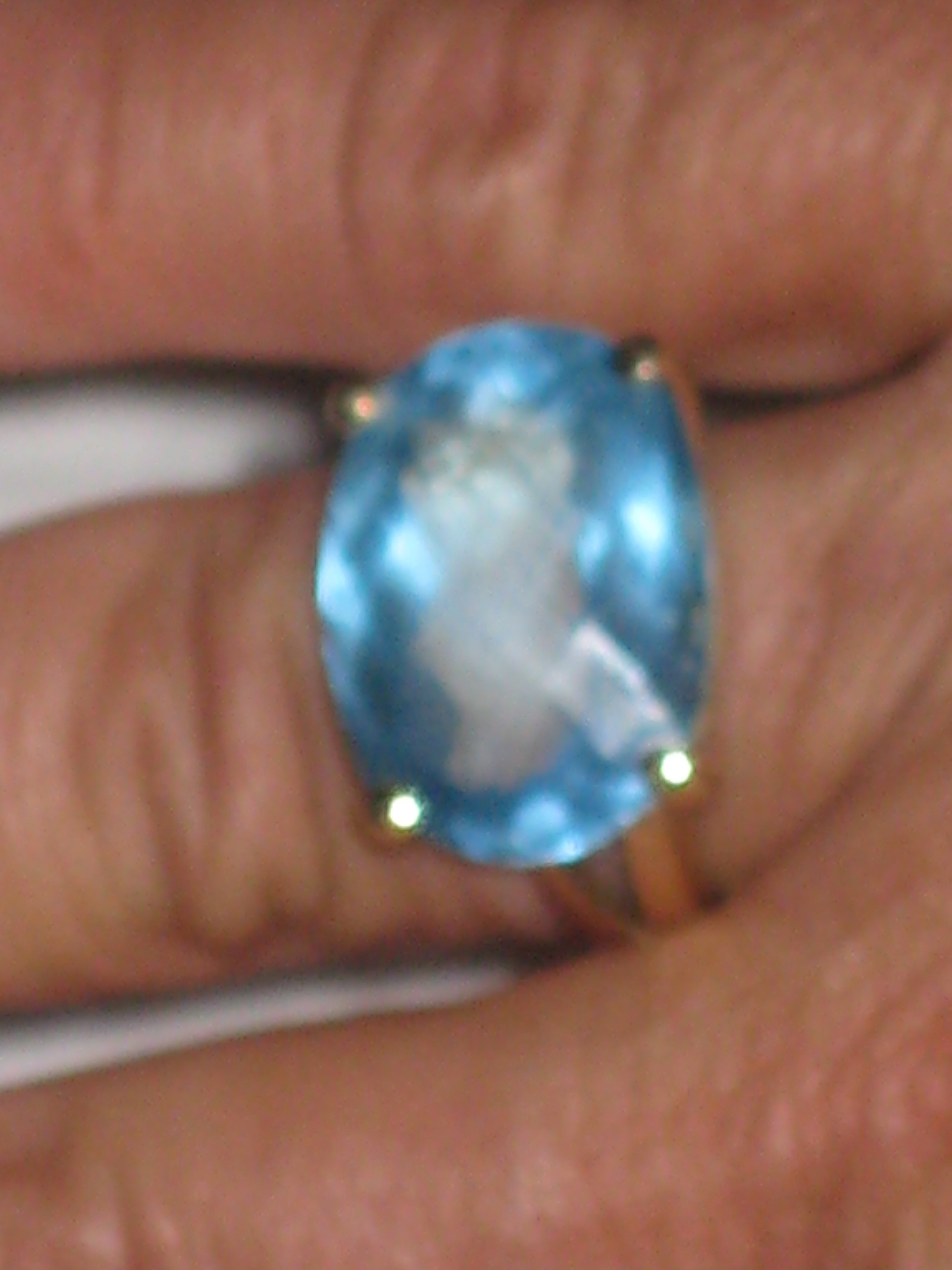 13 carat london blue topaz ring.14 carat gold, size 7.