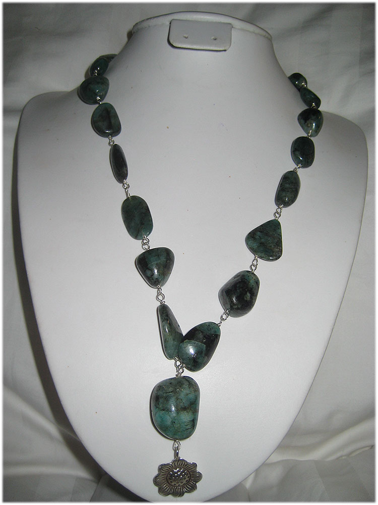 Stunning emerald nugget necklace with bali flower pendant